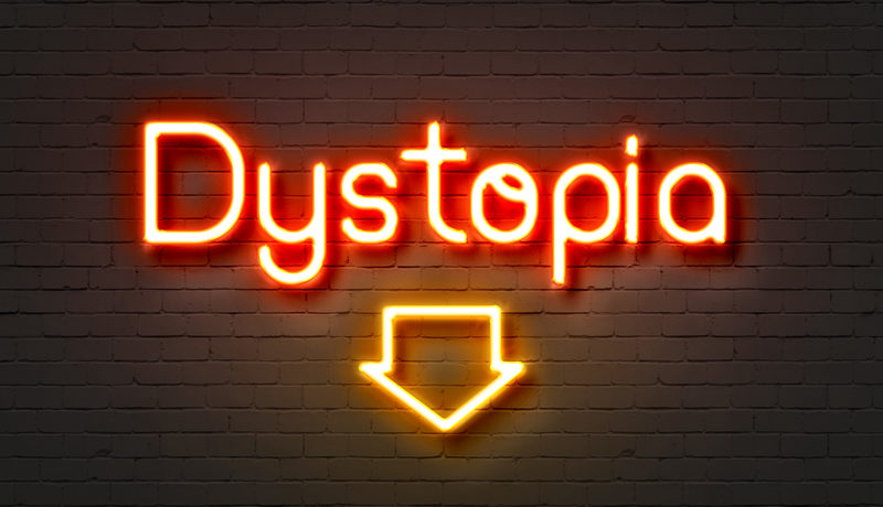 Dystopia neon sign on brick wall background.